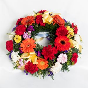 Bright Wreath Mixed Bright Flowers - Funerals - Flowers R Us